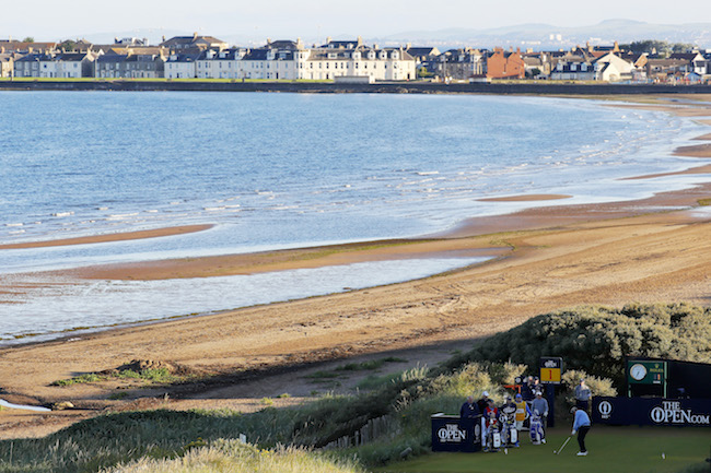 Watch Colin Montgomerie's opening shot and bunker trouble at the 145th Open