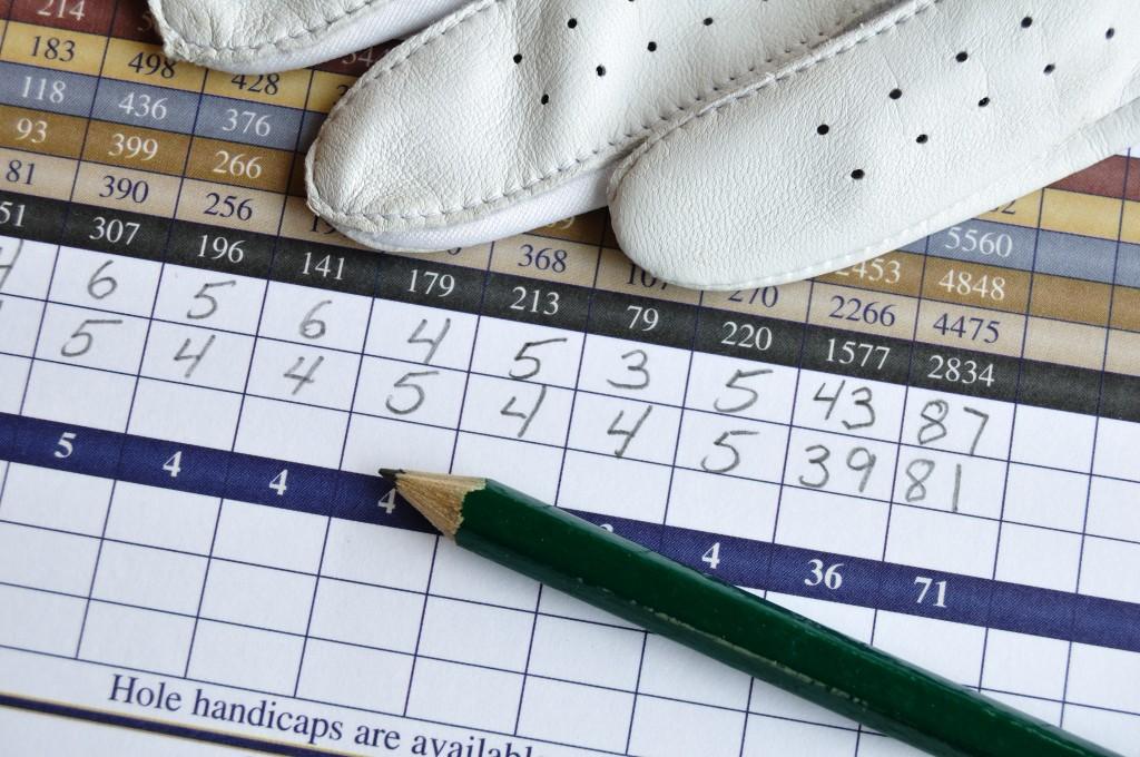 Golf Score Card with Glove and Green Pencil