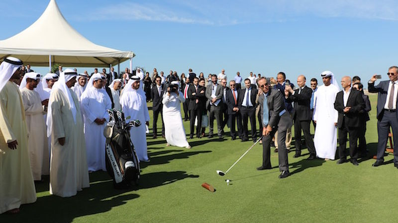 2015 12 Troon Golfs Area Managing Director Senior Vice President Middle East Mark Chapleski Hits The First Tee Shot To Officially Open Al Zorah Golf Club