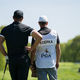 Brooks Koepka And Caddie