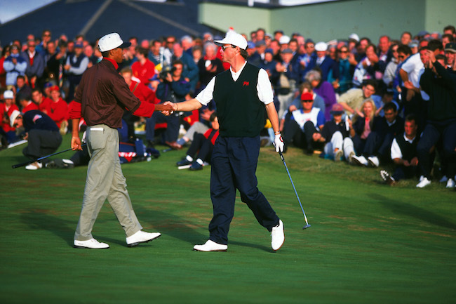 Gary Wolsteholme shaking hands with Tiger Woods.