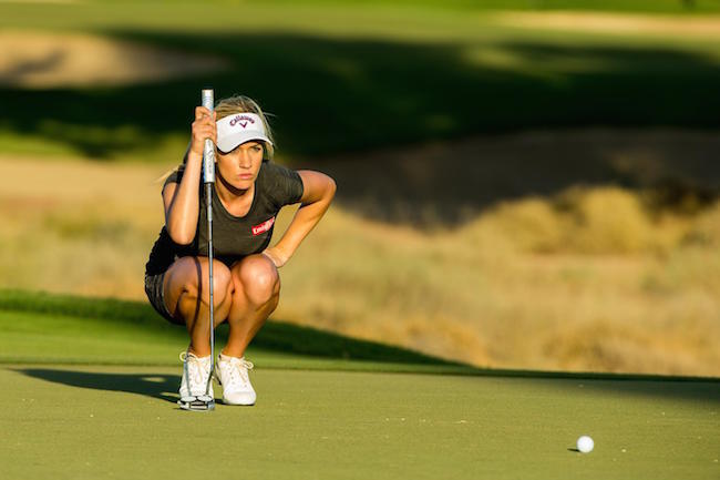 Paige Spiranac of the USA lines up a putt on the 15th hole during the second round