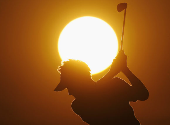 Golfer Playing In Sunshine