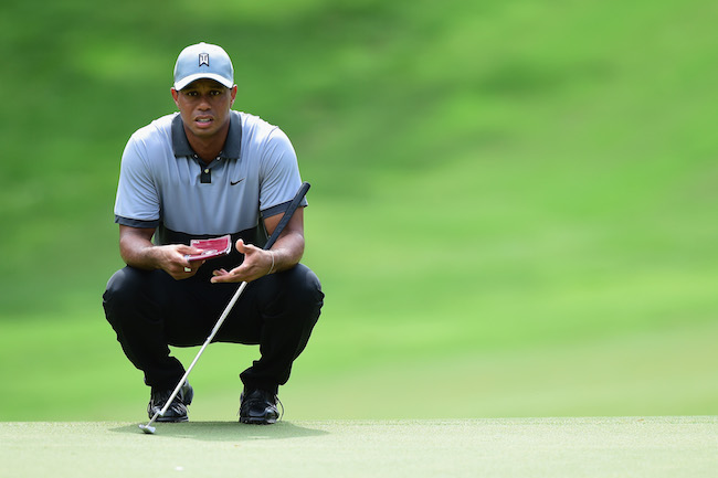 GEAR SHORTS  Tiger's putter, Kuchar's late club search