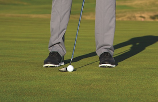 Position your weight better over putts